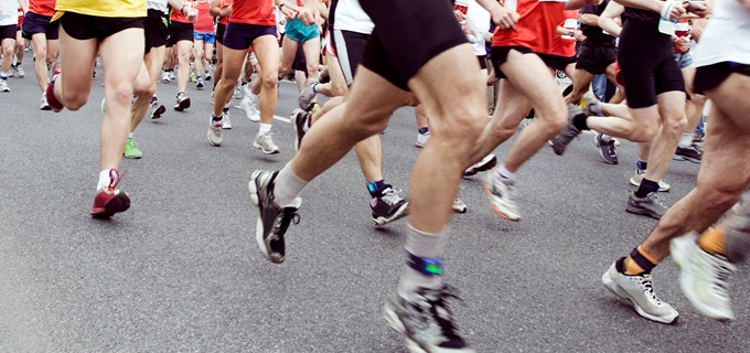 Runners running in marathon race in city
